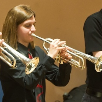 Cailyn Pease plays the trumpet